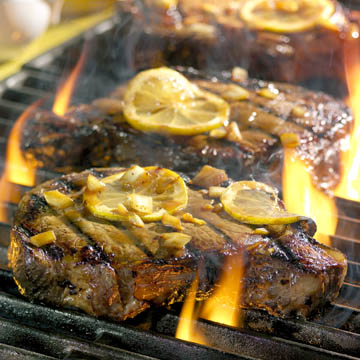 steaks on grill with fire - food photography